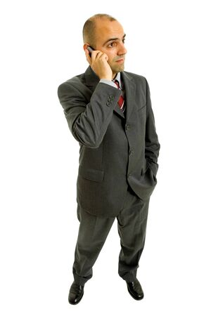 young business man looking with his phone, isolated photo