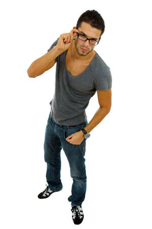 20s: young casual man full length in a white background