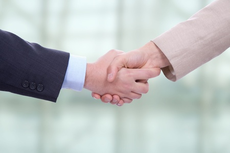 deal making: Business men in a handshake at the office Stock Photo