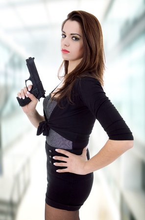 young beautiful woman with a gun photo