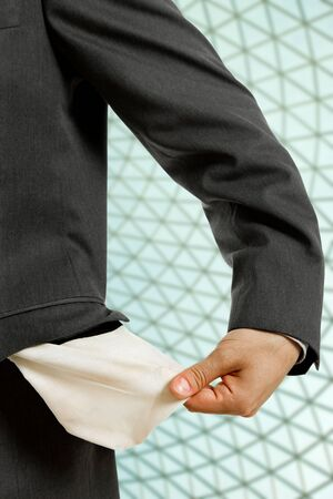 business man holding his empty pocket, detail photo
