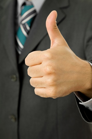 hand going thumb up, business man detail photo