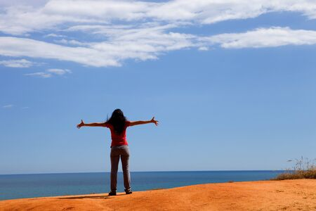 young happy woman at the coast with open arms Stock Photo - 9973236