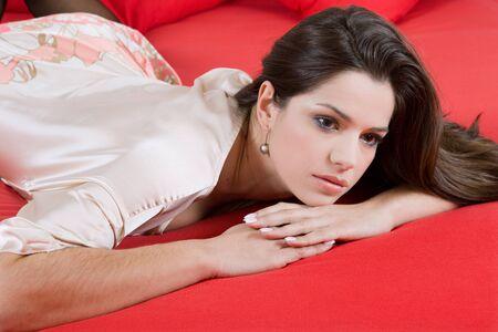an young beautiful sensual woman in bed photo