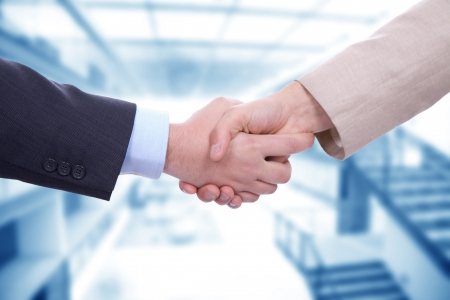 business relationship: Business men in a handshake at the office Stock Photo
