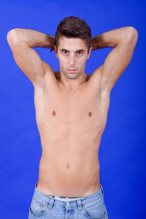 young casual topless man on a blue background Stock Photo - 10387627