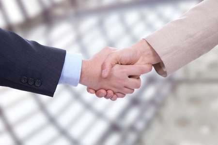 customer relationship: Business men in a handshake at the office Stock Photo
