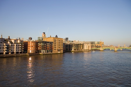 London view, river thames at end of the day photo