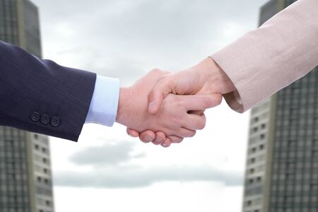 Business men in a handshake at the office photo