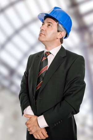 An engineer with blue hat at the office photo