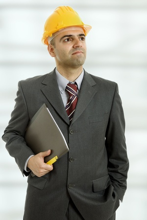 An engineer with yellow hat at the officce Stock Photo - 10587860
