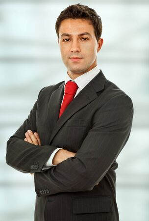 an young business man portrait at the office photo