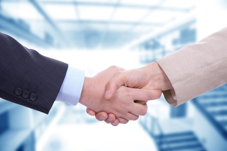 Business men in a handshake at the office Stock Photo