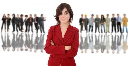 empleados trabajando: mujer de negocios en frente de un grupo de personas Foto de archivo
