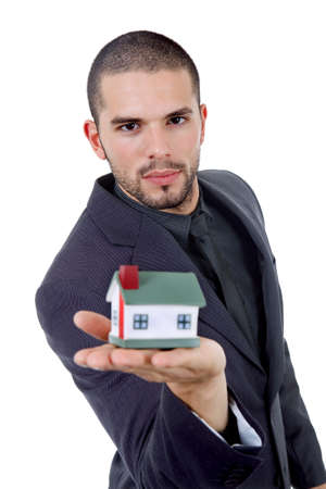 young businessman with a small house in his hand photo