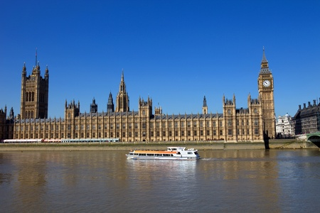 London view, Big Ben, Parliament, boat and river Thames