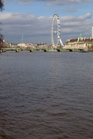 the london eye and the thames river in london, UK