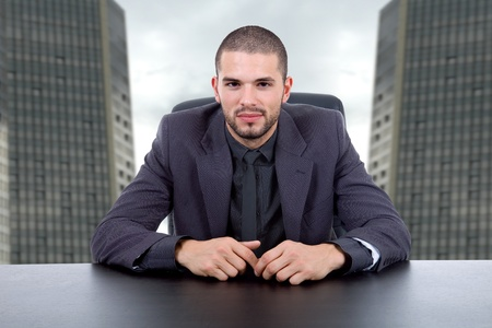 young business man on a desk at the office photo
