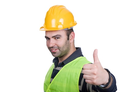 Worker wearing hard hat and going thumb up photo