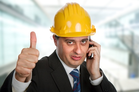 An engineer with yellow hat going thumbs up photo