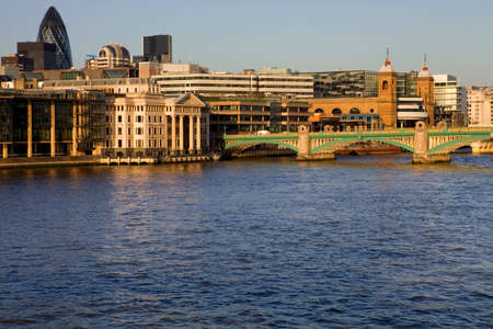 London view, river thames with some old and new buildings photo