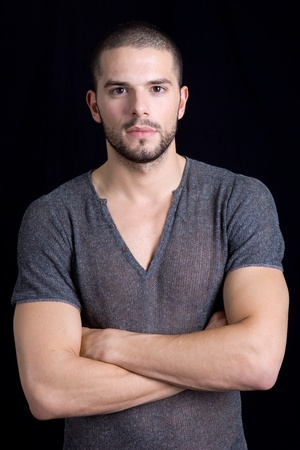 young casual man portrait on a black background Stock Photo - 12867074