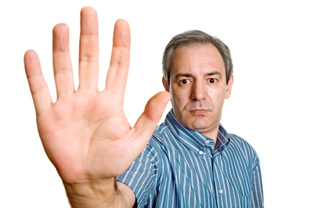mature man making stop with his hand photo
