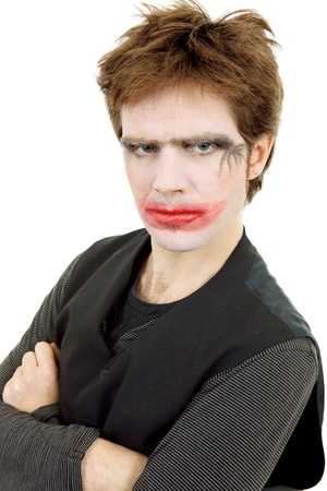 young man dressed as joker, isolated on white