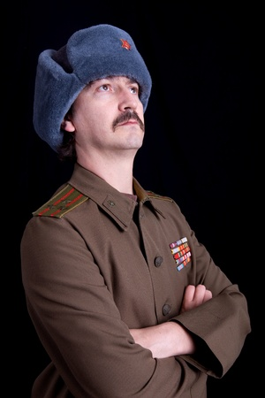 young man dressed as russian military, studio photo