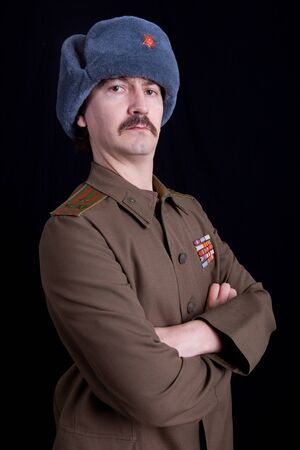 army face: young man dressed as russian military, studio