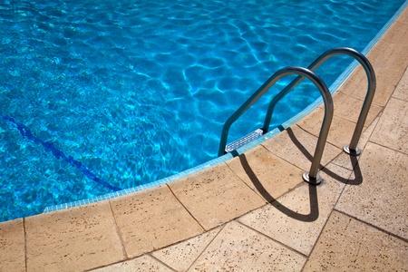 swimming pool blue water detail in summer time Standard-Bild
