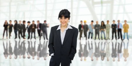 business woman in front of a group of people Stock Photo - 13568307