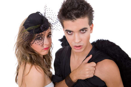 teen couple playing as actors on white background photo