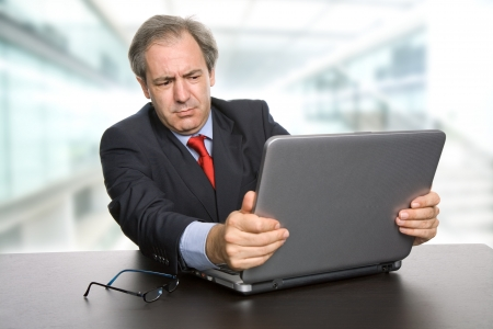 mature business man working with his laptop Stock Photo - 13689713