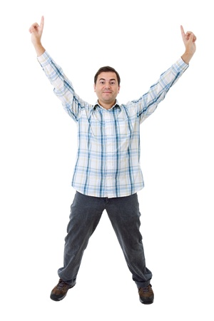 arms raised: young casual man winning, isolated on white Stock Photo