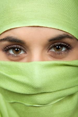 young woman with a veil, close up portrait, studio picture photo