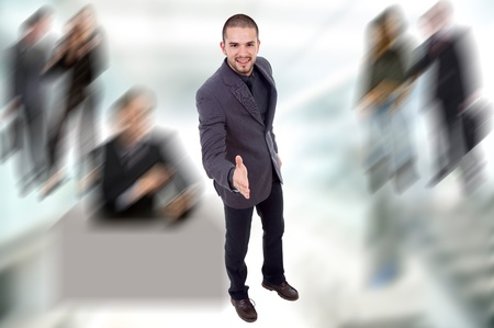 young business man full body offering his hand photo