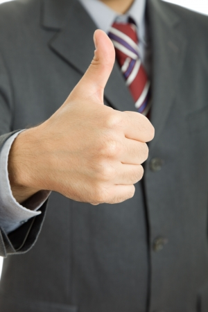 Businessman going thumbs up, close up picture photo