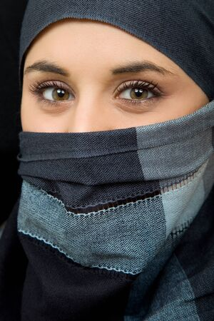 arab girl: young woman with a veil, close up portrait, studio picture Stock Photo