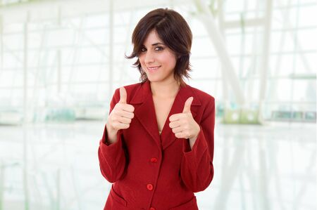 young business woman portrait going thumbs up Stock Photo - 14524657