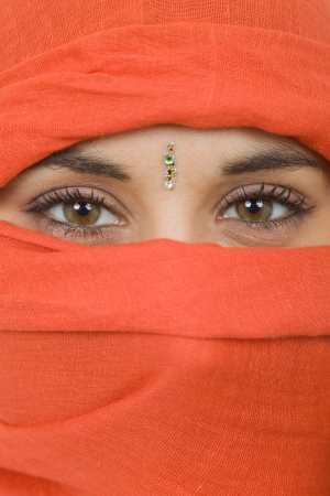 young woman with a veil, close up portrait, studio picture photo