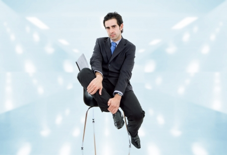 young businessman on a chair at the office photo