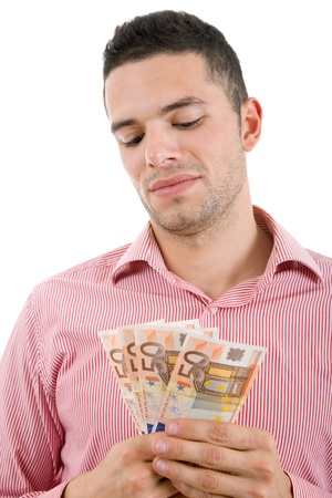 young casual man with lots of money Stock Photo