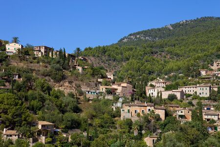 picturesque and historic village of Deia in the Tramuntana mountains, Mallorca, Spain photo