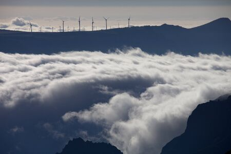 Mountains of Madeira island above the clouds at Pico do Areeiro and Ruivo photo