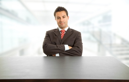 desk work: young business man on a desk at the office
