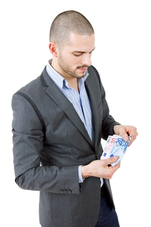 young casual man with lots of money, isolated photo