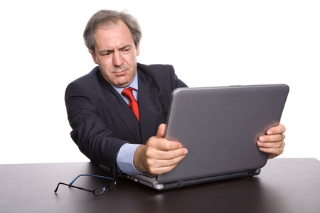 mature business man working with his laptop photo