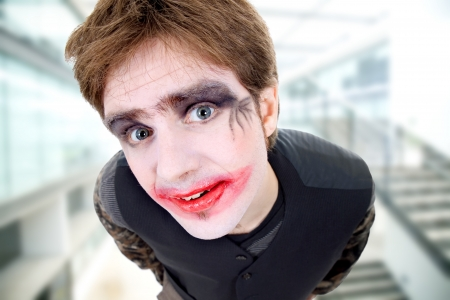 crazy young man dressed as joker photo