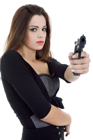 young beautiful woman with a gun, isolated Stock Photo - 15255481